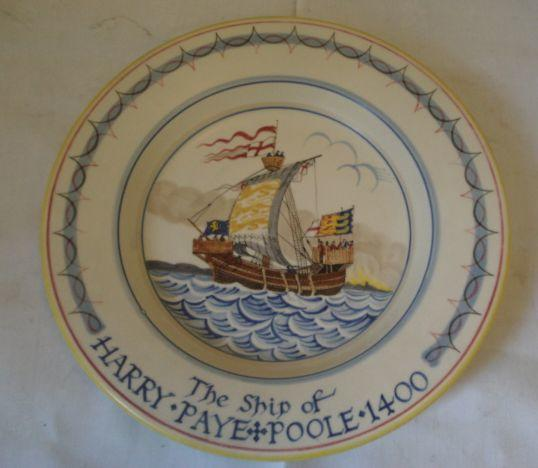 A Poole Pottery plate, painted by Nellie Blackmore after Arthur Bradbury, 'The Ship of Harry Payne Poole', inscribed verso 'This dish was made and painted at the Poole Pottery in the year 1955', 27cm.