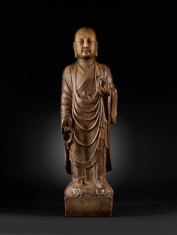 A rare and important marble figure of a Buddhist disciple Tang Dynasty, dated by inscription to AD718
