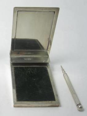 A silver travelling notebook holder by Asprey & Co Ltd, London 1927