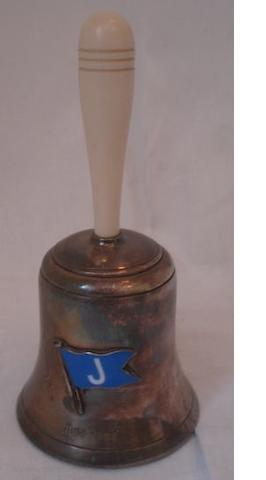 Dunhill: silver plated and ivorine hand bell desk lighter,applied with a blue enamelled 'J' pennant.