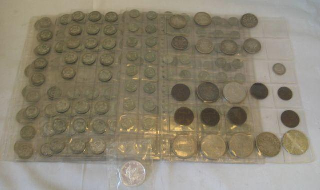 A collection of mainly 1900-1946 coinage, held in plastic wallet sheets approximately 162 half Crowns, 192 Florins - two Shillings, 258 Shillings, 107 Sixpences also 9 pre 1900 half Crowns, 2 Marie Thersa Thalers, 2 silver Canadian 5 Dollar coins, some copper coins, Farthings, Commemorative Crowns, decimal coins and bank notes.