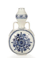 A Chinese blue and white moonflask (restored) (as per Sotheby's catalogue description lot 445, 11th March 2004)