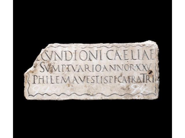 A Roman marble columbarium panel