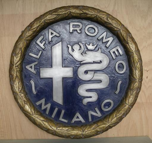 An Alfa Romeo garage display roundel,