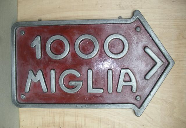 A '1000 Miglia' garage display emblem,
