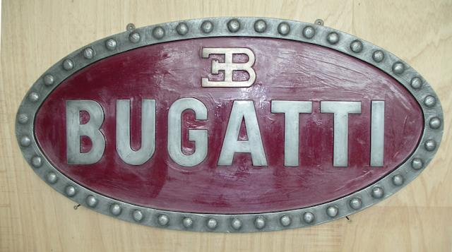 A Bugatti garage display emblem,