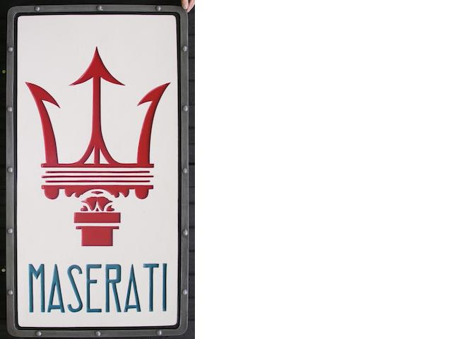 A Maserati garage display emblem,