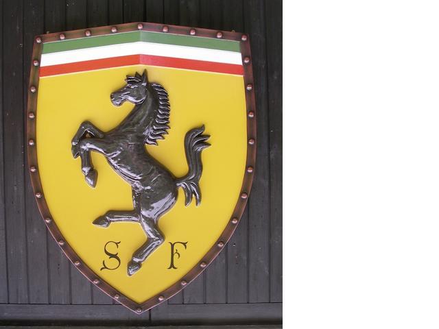 A Ferrari garage display shield,