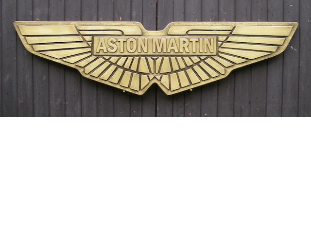 An Aston Martin garage display emblem,