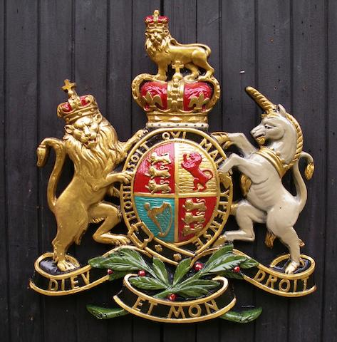 A hand-painted Royal Endorsement Coat of Arms display emblem,