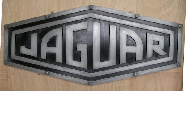 A Jaguar garage display emblem,