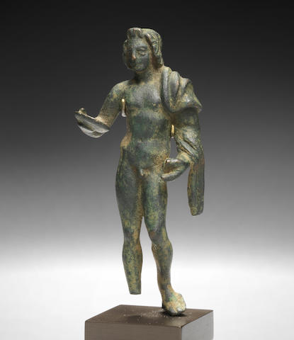 A Roman bronze figure of a young man