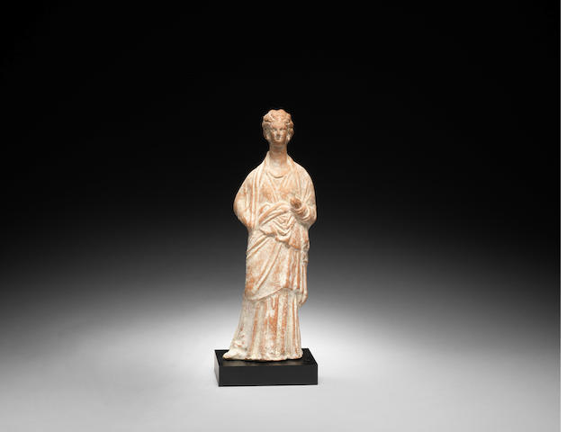 A Greek terracotta female figure