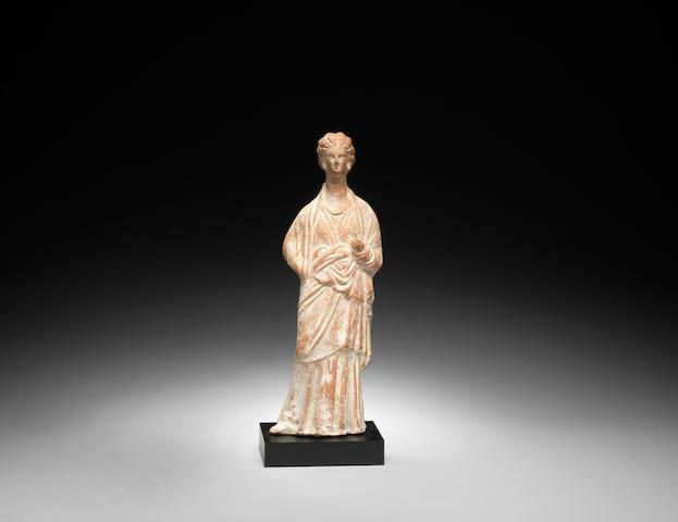 A Greek terracotta female figure