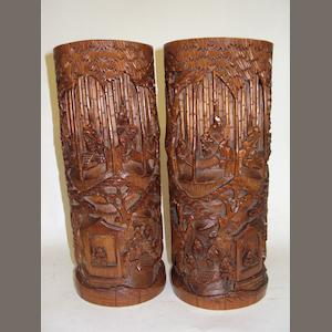 A pair of Chinese carved bamboo brush pots