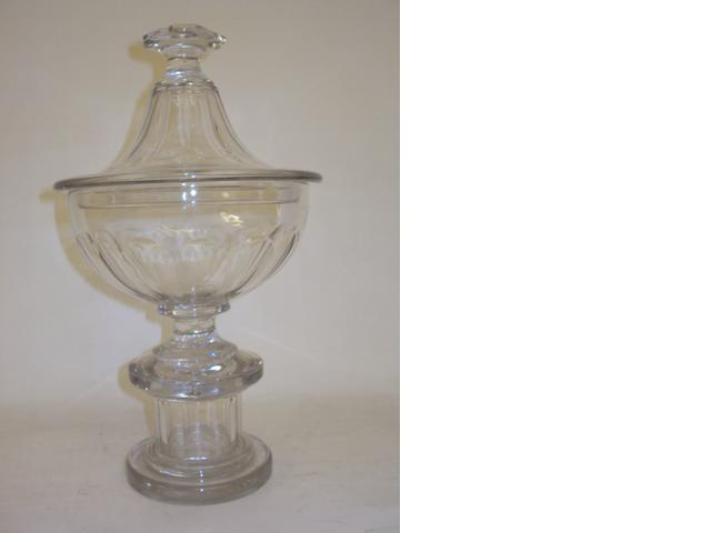An early 19th century cut glass urn and cover