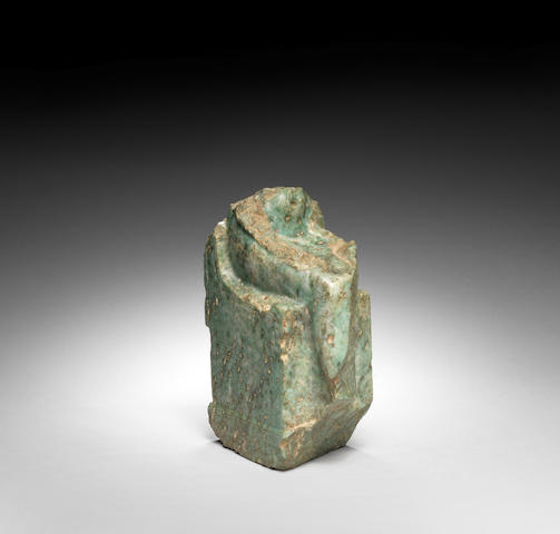 An Egyptian green anorthosite gneiss fragment of a seated female figure