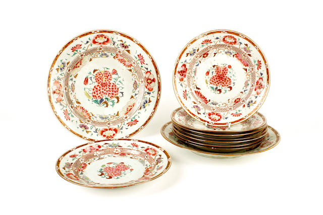 A pair of Chinese export famille rose plates and eight smaller plates, 18th century