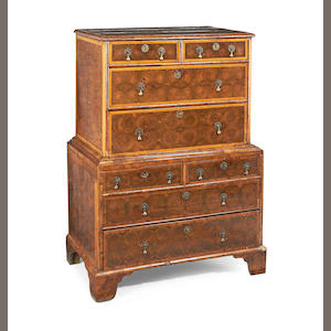 A William and Mary oyster veneered walnut and fruitwood banded chest-on-chest