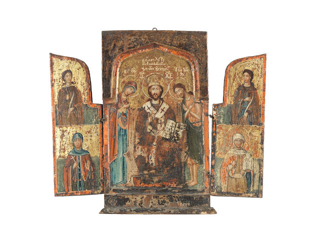 A triptych of the Deisis, with four female Saints Greek, possibly Western Islands, late 18th century<BR /> height: 29.2cm (11 1/2in).; length open: 33.7cm (13 1/4in).