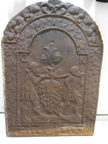 A cast iron fireback