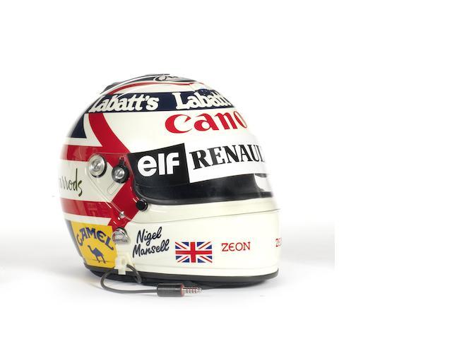 A Nigel Mansell Arai helmet,
