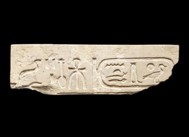 An Egyptian limestone relief fragment bearing the cartouche of Inyotef II