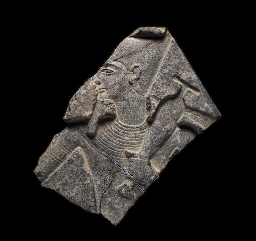 An Egyptian grano-diorite relief fragment