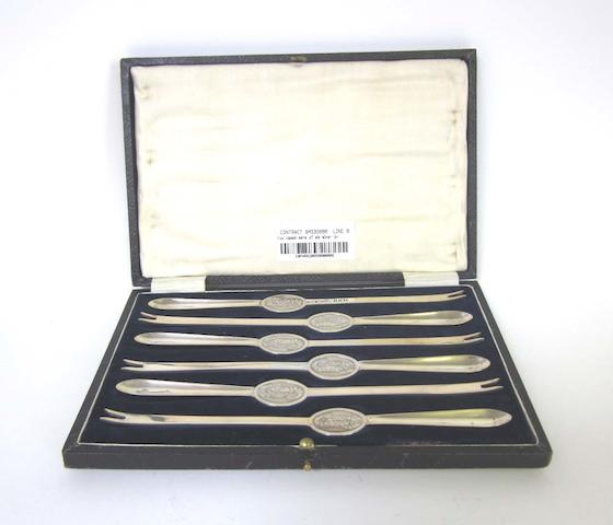 Two cased set of six silver lobster picks one by William Hutton & Sons Ltd, Sheffield 1937, the second set by James Deakin & Son, Sheffield 1927  together with a cased set of six silver coffee spoons and a cased set of six metalware forks, by W & S Sorensen, marked Sterling Denmark,