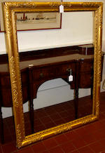 A pair of English early 20th Century carved and gilded frames