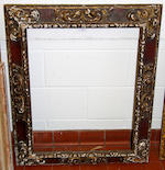 A Spanish early 20th Century carved, polychromed and gilded frame