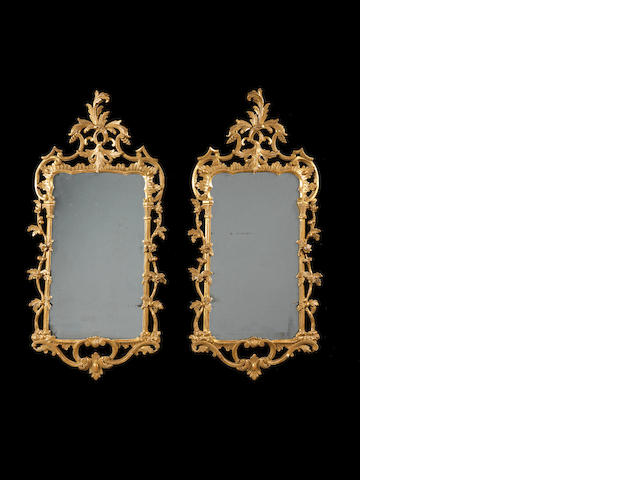 A pair of George III carved giltwood mirrors