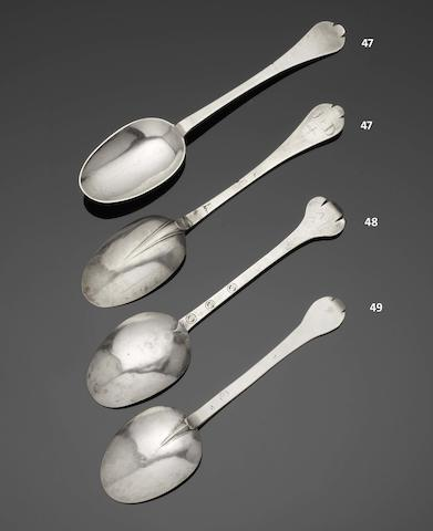 A William III pair of silver trefid spoons by William Scarlett, marks rubbed, London 1701