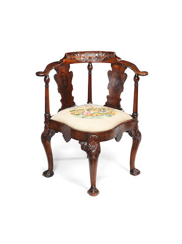A George II Irish carved walnut corner chair