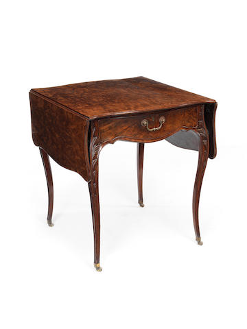 A George III mahogany and 'plum-pudding' mahogany Pembroke table in the manner of John Cobb