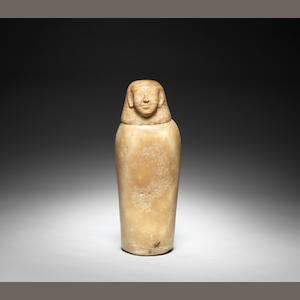 An Egyptian alabaster canopic jar and stopper 2