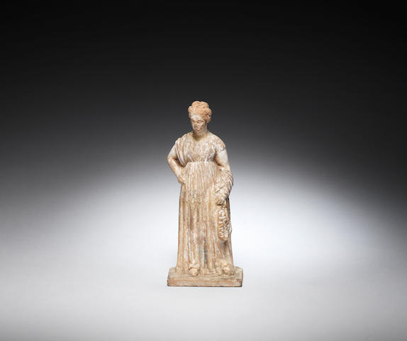 A terracotta female figure