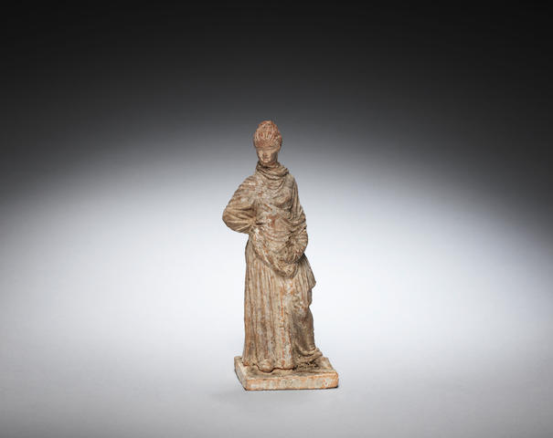 A small terracotta female figure
