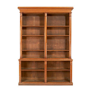 A pair of William IV oak open bookcases