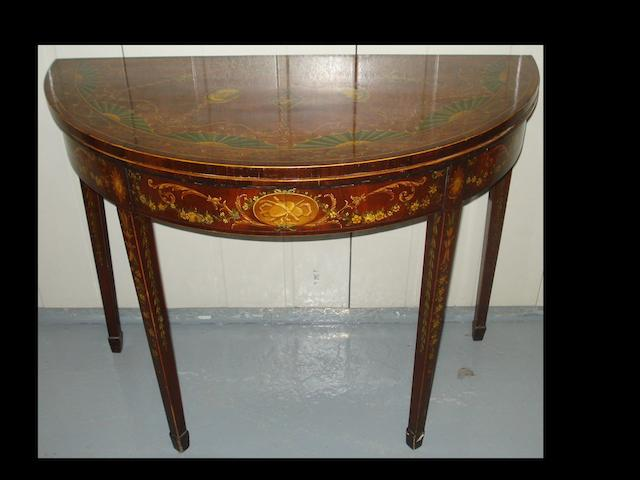 A George III mahogany foldover table,