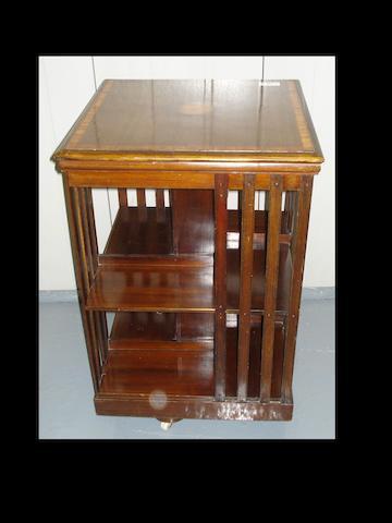 An Edwardian mahogany amd satinwood beaded revolving bookcase,