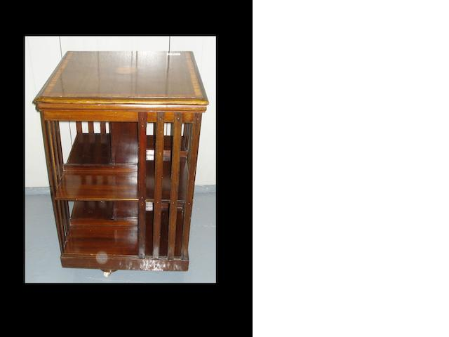 An Edwardian   mahogany amd satinwood beaded revolving bookcase,