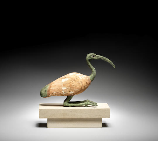 An Egyptian bronze and wood ibis
