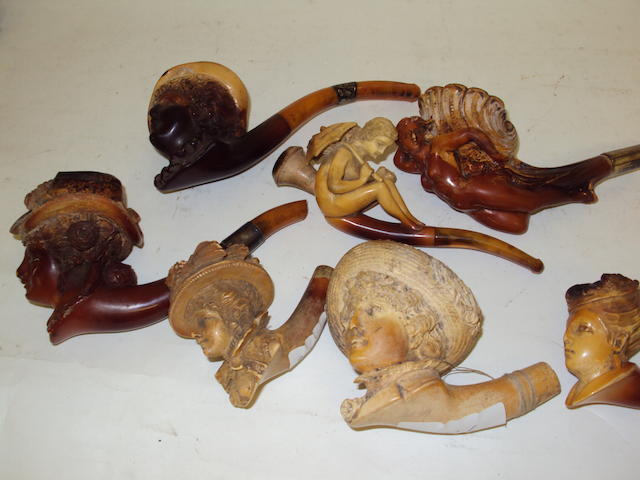 A collection of carved meerschaum pipes