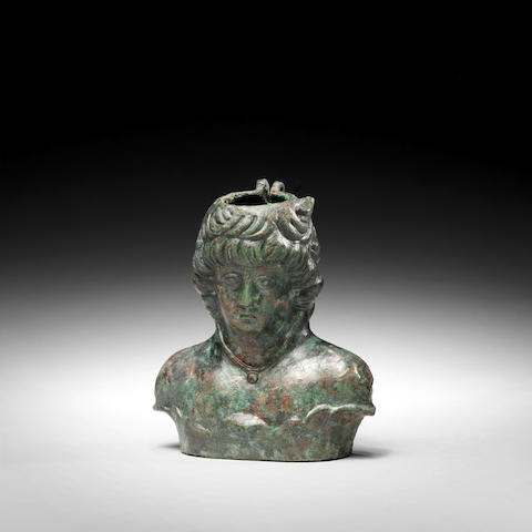 A Roman bronze balsamarium in the form of Antinous