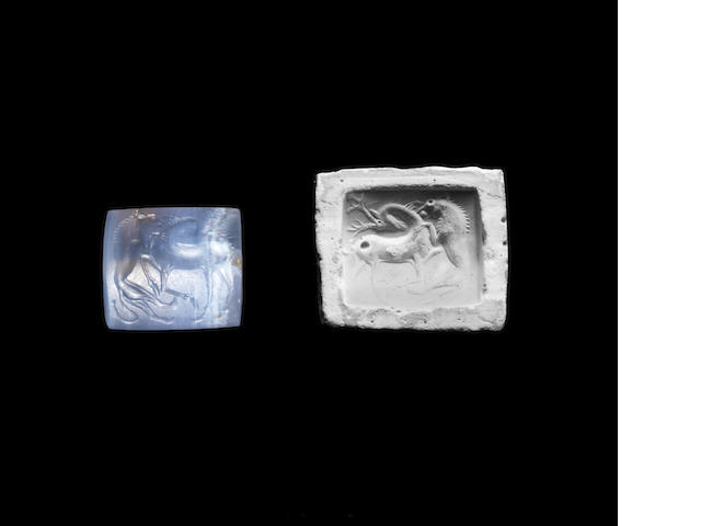 A Minoan blue chalcedony gem with lion and antelope