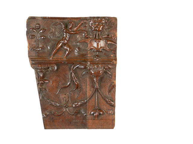 An assortment of four carved wood panels