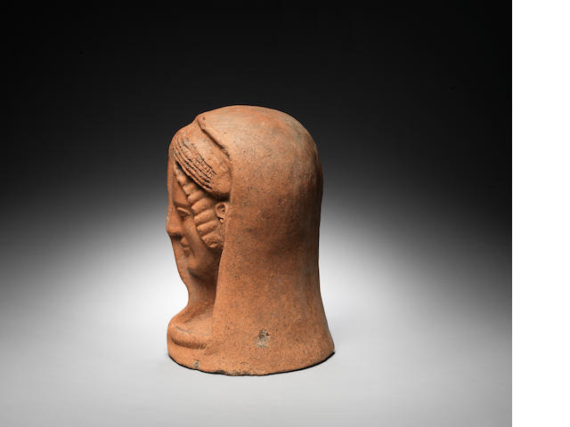 An Etruscan terracotta votive female 'half' head