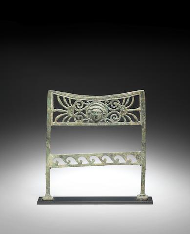 A Roman bronze stool fragment