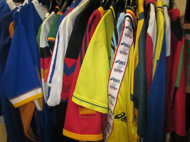 A collection of replica football, cricket shirts